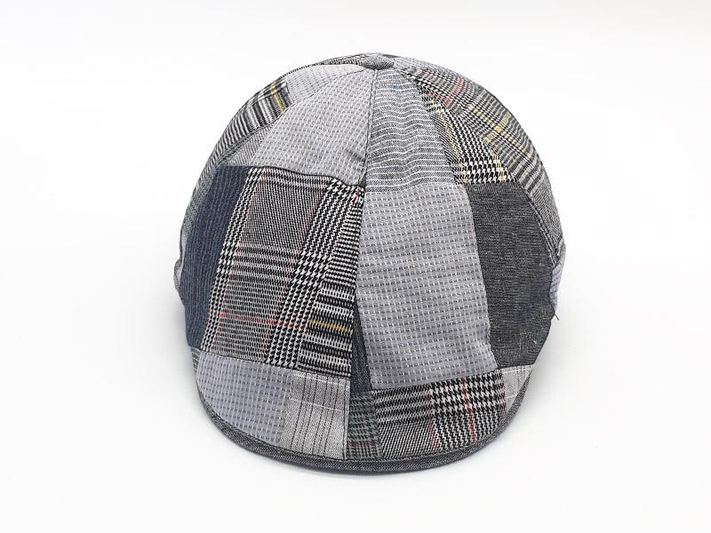Coppola patchwork base grigio a quadri con bottone