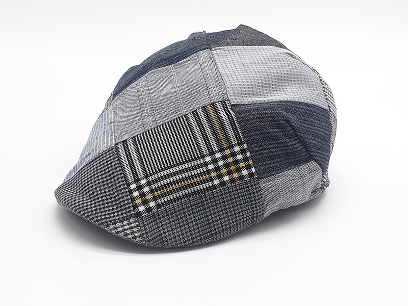Coppola patchwork base grigio a quadri con bottone unisex