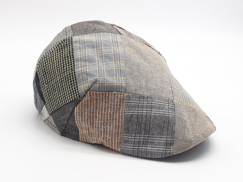 Coppola patchwork base marrone/grigio a quadri con bottone unisex
